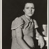 Daughter of migratory family in Farm Security Administration (FSA) labor camp. Calpatria, Imperial Valley, California.