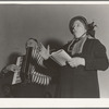 Adjutant and his wife sing. Salvation Army, San Francisco, California.