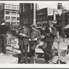 Salvation Army, San Francisco, California. Unemployed young men pause a moment to loiter and watch, and then pass on.