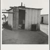 Toilet for ten cabins, men, women, and children. In Arkansawyers auto camp. Greenfield, California.