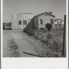 House which adjoins that of family described in 19553-E. There are approximately one hundred such homes, each with about an acre at Highway City, California, which show various degrees of ability in self resettlement. Nearly all are on Works Progress Administration (WPA)