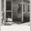 Tulare County, Farmersville, California. Farm Security Administration (FSA) camp for migratory agricultural workers. Entering clinic of Agricultural Workers' Health and Medical Association (FSA) for nurse's help with sick baby.