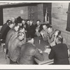 Farm Security Administration (FSA) camp for migratory agricultural workers. Farmersville, California. Meeting of camp council.