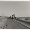 Between Tulare and Fresno. Migrants on the road. California. See general caption.