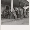Fourth of July, near Chapel Hill, North Carolina. Rural filling stations become community centers and general loafing grounds. The men in the baseball suits are on a local team which will play a game nearby. They are called the Cedargrove Team.