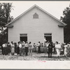 Congregation gathers in groups to talk after services are over. Wheeley's Church, Person County, North Carolina.