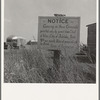 Sign on camp site opposite potato packing sheds. Tulelake, Siskiyou County, California. General caption number 63-1.