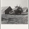 Migratory family, come to Klamath Basin for potato harvest, moving into tent in the new mobile unit. (FSA - Farm Security Administration). Tents are provided. Merrill, Klamath County, Oregon.