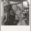 Mother and two children on the road. Tulelake, Siskiyou County, California. General caption number 65