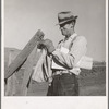 Farmer getting the morning mail. Gem County, Idaho.