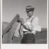 Farmer getting the morning mail. Gem County, Idaho
