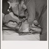 The doctor examines the boy from Texas. In mobile unit of FSA (Farm Security Administration) camp, Merrill, Klamath County, Oregon. See general caption 62
