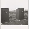 Twenty-four portable toilets, mobile camp (FSA - Farm Security Administration) equipment. Merrill, Klamath County, Oregon.