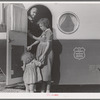 Young mother brings her child to the trailer clinic on the day when the doctor will be in camp to examine some of the children. Klamath County, Oregon. FSA (Farm Security Administration) camp.