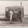 The doctor reassures the mother after having seen the sick baby in the trailer. Merrill, Klamath County, Oregon, at FSA (Farm Security Administration) mobile camp