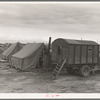 In mobile camp at end of season, cold day. Merrill, Klamath County, Oregon, FSA (Farm Security Administration) camp
