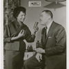 "Rose Morgan and husband Joe Louis, posing with bottles of her cosmetics brand ""My Man"""