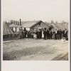 Men, women and children waiting in line to be fed. Tent City, Shawneetown, Illinois.