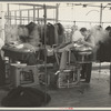 Steam pressing the cloth is one process in manufacturing women's coats at Jersey Homesteads, Hightstown