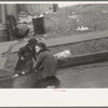 Children playing in the gutter on 139th Street just east of St. Anne's Avenue, Bronx, New York
