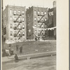 Apartment houses as viewed through vacant lot. In vicinity of 139th Street just east of St. Anne's Avenue Bronx, New York