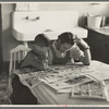 Children reading Sunday papers, Rustan brothers' farm near Dickens, Iowa. Note convenience of running water in background. This farm was formerly owner operated but they are now tenants of Metropolitan Life.