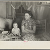 Mrs. Charles Benning and baby in their shack home at Shantytown, Spencer, Iowa