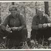 Two lumberjacks waiting for a ride. Near Gheen, Minnesota.