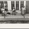 Wealthy Cajun farm family sitting on porch of their new modern home near Crowley, Louisiana. Joseph La Blanc family