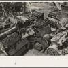 Discarded automobile motors at junkyard, Abbeville, Louisiana.