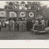 Crowd listening to barker at sideshow, state fair, Donaldsonville, Louisiana.