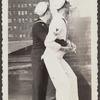 Photograph of sailors embracing on rooftop