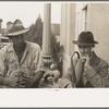 Two men in front of post office, Lafayette, Louisiana.