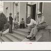 Men sitting on steps of post office, Lafayette, Louisiana.