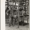 Cut-over farmer near Amite, Louisiana, drawing water from well.