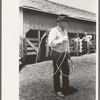 Cowboy with rope on cattle ranch near Spur, Texas.