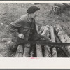 Farmer sawing wood near Bradford, Vermont.