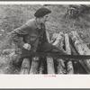 Farmer sawing wood near Bradford, Vermont.