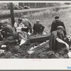 Railroad workers eating lunch along the railroad tracks, Windsor Locks, Conn.