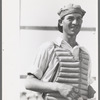 Migratory laborers like to play baseball. Here is one of them in a catchers uniform at the Agua Fria Migratory Labor Camp, Arizona
