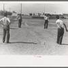 Pitching horseshoes at the Agua Fria Migratory Labor Camp, Arizona