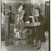 Mae West and unidentified actor (holding boxes) in the stage production Diamond Lil