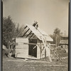 Orville White building a small shed on his farm near Northome, Minnesota