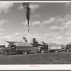 Trucks loaded with sugar beets, factory in background, East Grand Forks, Minnesota