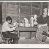 Mother and son in combined, kitchen, living room and bedroom, beet workers near Fisher, Minnesota