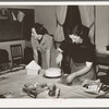 Wife of Jaycee member cutting cake at buffet supper at the high school. Eufaula, Oklahoma. See general caption number 25