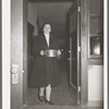 Wife of Jaycee member bringing food to the buffet supper at the high school. Eufaula, Oklahoma. See general caption 25