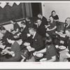 Jaycee members and their wives at buffet supper at the high school. Eufaula, Oklahoma. See general caption number 25
