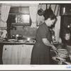 Hostess cutting and serving cake at home demonstration club meeting in McIntosh County, Oklahoma