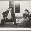 Farmer with his wife and child eating pie at pie supper. McIntosh County, Oklahoma. See general caption number 24